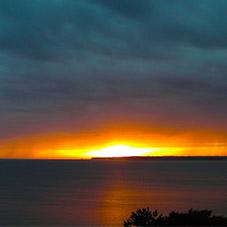 Sonnenaufgang und Regenschauer an der Eckernförder Bucht